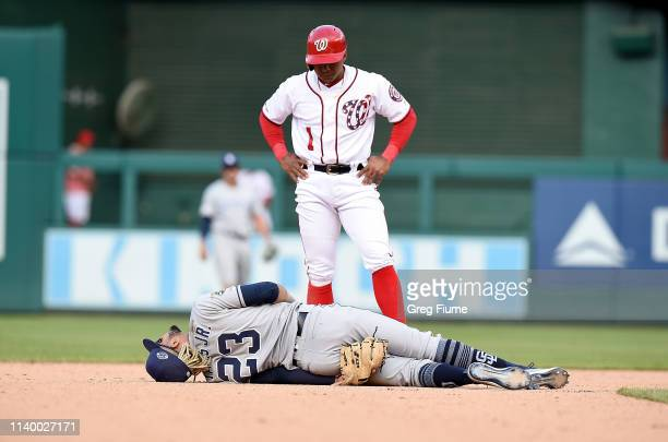Wilmer Difo of the Washington Nationals looks on as Fernando Tatis Jr #23 of the San Diego Padres is injured on a play in the 10th inning at...