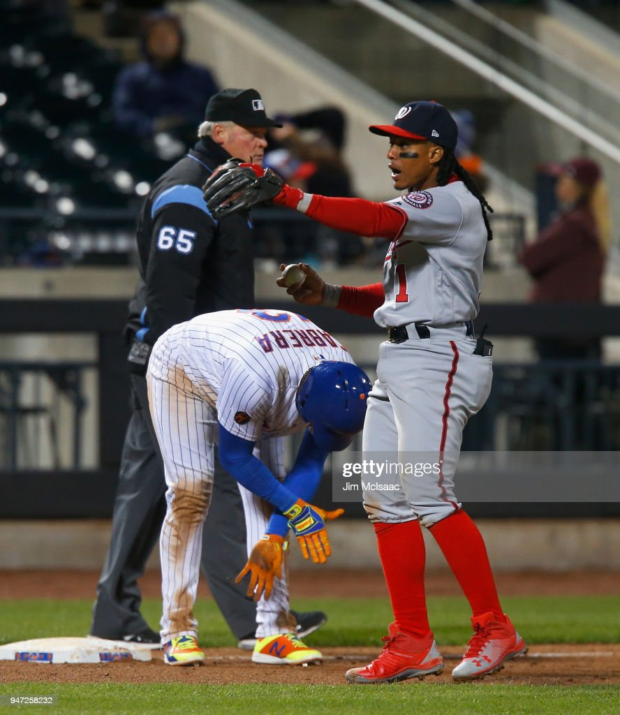 Wilmer Difo #1 of the Washington Nationals reacts after tagging out Asdrubal Cabrera #13 of the New York Mets at third base for the second out of the ninth inning at Citi Field on April 16, 2018 in the Flushing neighborhood of the Queens borough of New York City.