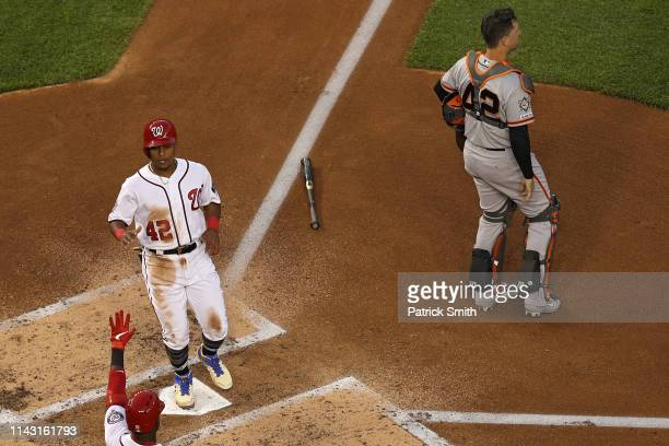 Wilmer Difo of the Washington Nationals scores against the San Francisco Giants during the second inning at Nationals Park on April 16 2019 in...