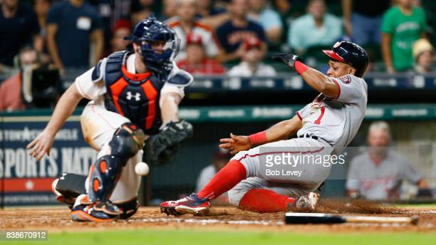 Wilmer Difo of the Washington Nationals scores in he eleventh inning on a sacrifice fly by Anthony Rendon of the Washington Nationals as Brian McCann...