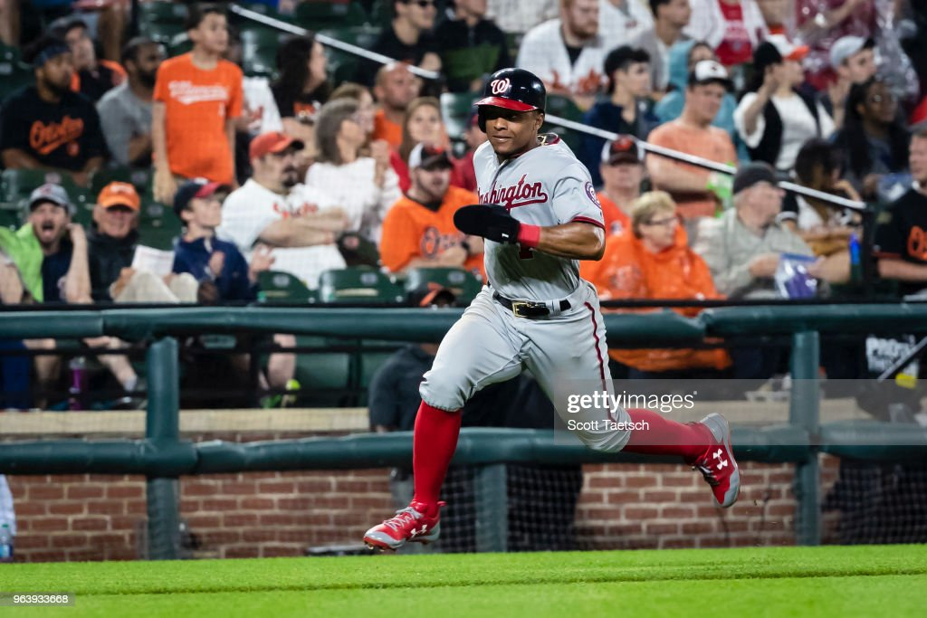 Wilmer Difo #1 of the Washington Nationals scores on a hit by Juan Soto #22 against the Baltimore Orioles during the seventh inning at Oriole Park at Camden Yards on May 30, 2018 in Baltimore, Maryland.