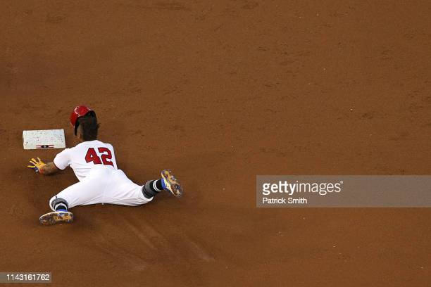 Wilmer Difo of the Washington Nationals slides into second base as he doubles San Francisco Giants during the second inning at Nationals Park on...