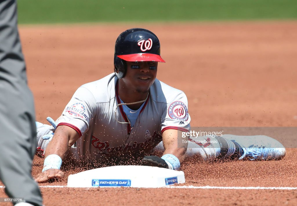 Wilmer Difo #1 of the Washington Nationals slides safely into third base as he advances on a throwing error in the second inning during MLB game action by Russell Martin #55 of the Toronto Blue Jays at Rogers Centre on June 17, 2018 in Toronto, Canada.