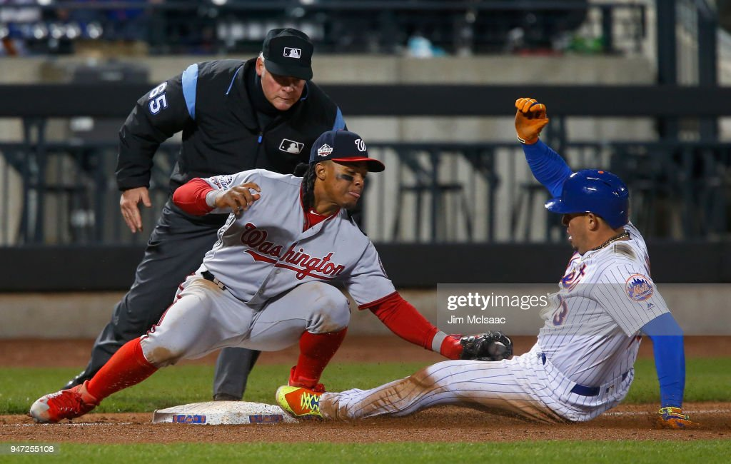 Wilmer Difo #1 of the Washington Nationals tags out Asdrubal Cabrera #13 of the New York Mets for the second out of the ninth inning at Citi Field on April 16, 2018 in the Flushing neighborhood of the Queens borough of New York City.