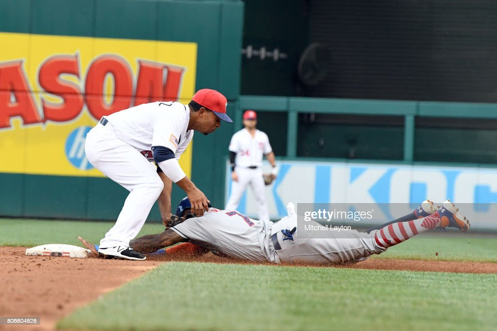 Wilmer Difo #1 of the Washington Nationals tags out Jose Reyes #7 of the New York Mets trying to steal second base in the third inning during a baseball game at Nationals Park on July 3, 2017 in Washington, DC.