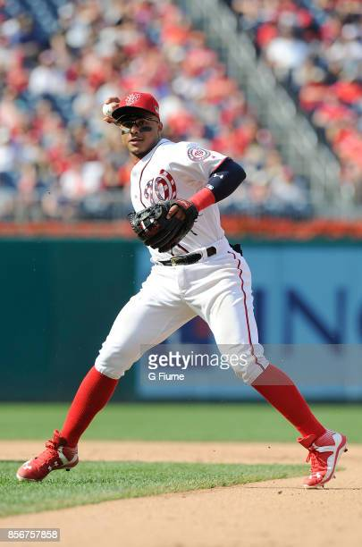 Wilmer Difo of the Washington Nationals throws the ball to first base against the Philadelphia Phillies at Nationals Park on September 10 2017 in...