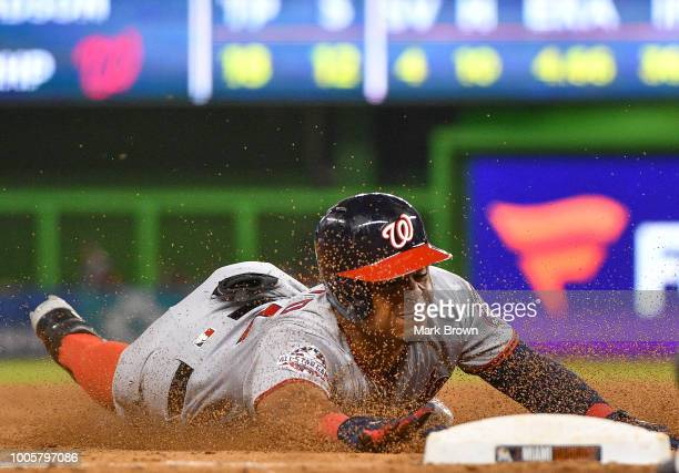 Wilmer Difo of the Washington Nationals triples in the ninth inning against the Miami Marlins at Marlins Park on July 26 2018 in Miami Florida
