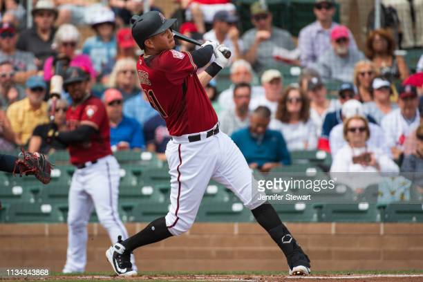 Wilmer Flores of the Arizona Diamondbacks hits a two run home run during the spring training game against the Cleveland Indians at Salt River Fields...