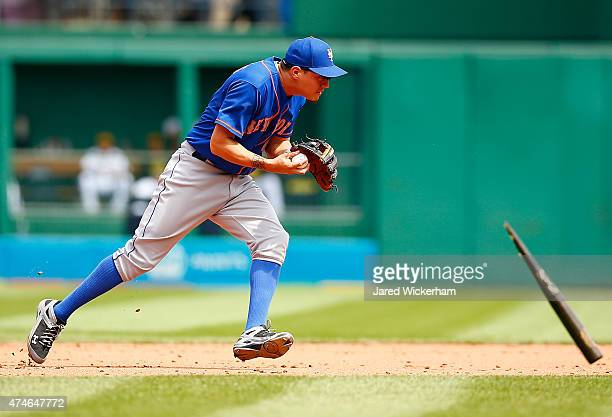 Wilmer Flores of the New York Mets avoids a flying broken bat while fielding a ground ball against the Pittsburgh Pirates during the game at PNC Park...