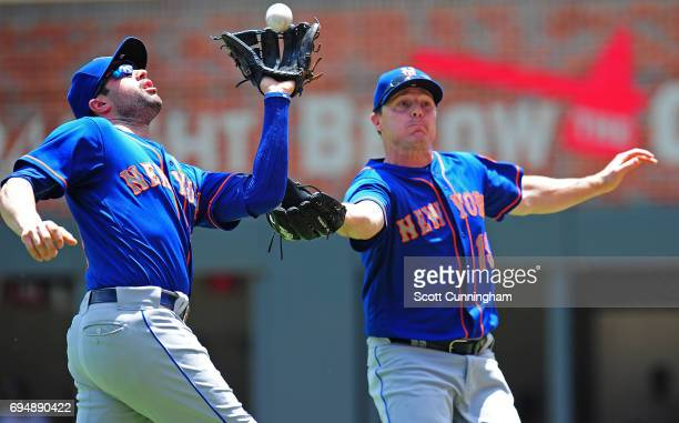 Wilmer Flores of the New York Mets catches a popup in front of Jay Bruce during the second inning against the Atlanta Braves at SunTrust Park on June...