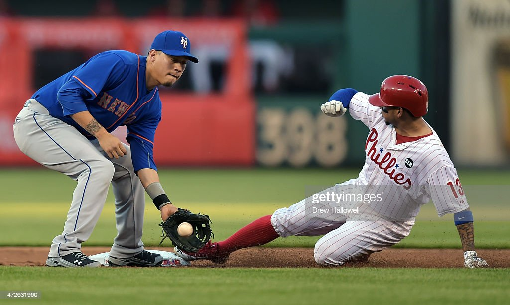 Wilmer Flores #4 of the New York Mets catches the ball as Freddy Galvis #13 of the Philadelphia Phillies slides safely into second base on a steal in the first inning at Citizens Bank Park on May 8, 2015 in Philadelphia, Pennsylvania.