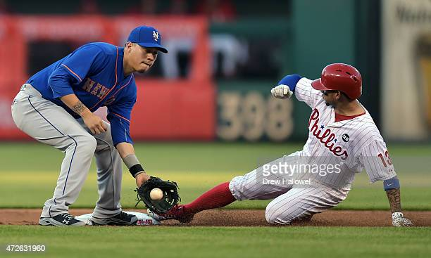 Wilmer Flores of the New York Mets catches the ball as Freddy Galvis of the Philadelphia Phillies slides safely into second base on a steal in the...