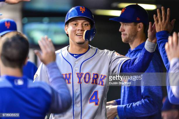 Wilmer Flores of the New York Mets celebrates a second inning run scored against the Colorado Rockies at Coors Field on June 19 2018 in Denver...