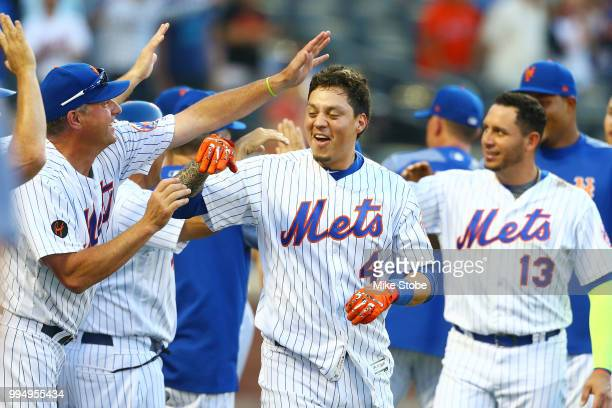 Wilmer Flores of the New York Mets celebrates after hitting a gamewinning walkoff home run in the 10th inning against the Philadelphia Phillies...