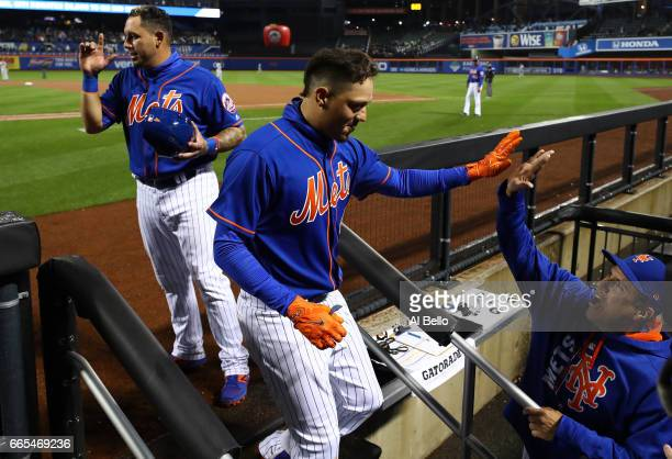 Wilmer Flores of the New York Mets celebrates after hitting a tworun home run in the sixth inning against the Atlanta Braves during their game at...