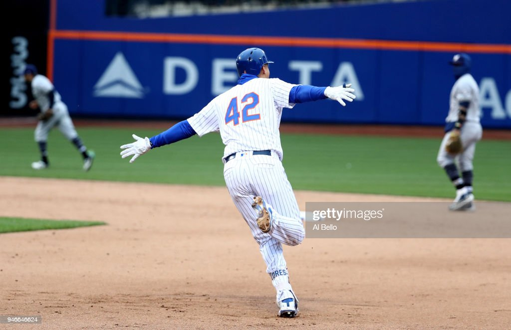 Wilmer Flores #4 of the New York Mets celebrates after hitting a walkoff home run in the ninth inning to win the game 3-2 against the Milwaukee Brewers at Citi Field on April 15, 2018 in New York City. All players are wearing #42 in honor of Jackie Robinson Day.