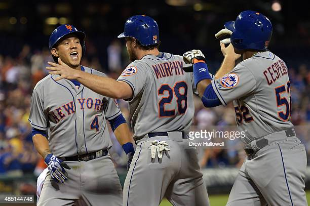 Wilmer Flores of the New York Mets celebrates his threerun home run with Daniel Murphy and Yoenis Cespedes in the fifth inning against the...