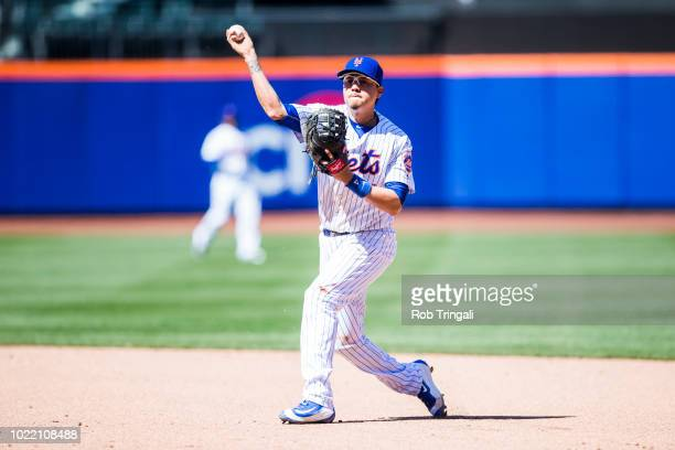 Wilmer Flores of the New York Mets defends his position during the game against the Miami Marlins at Citi Field on April 13 2016 in the Queens...