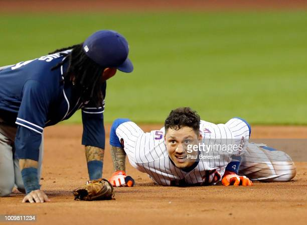 Wilmer Flores of the New York Mets ends up safe at second base after hitting an rbi single in the third inning during an MLB baseball game against...