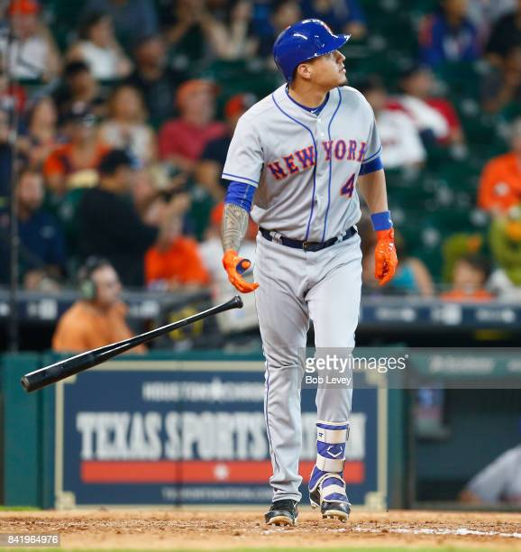 Wilmer Flores of the New York Mets hits a grand slam in the seventh inning against the Houston Astros in game one of a doubleheader at Minute Maid...