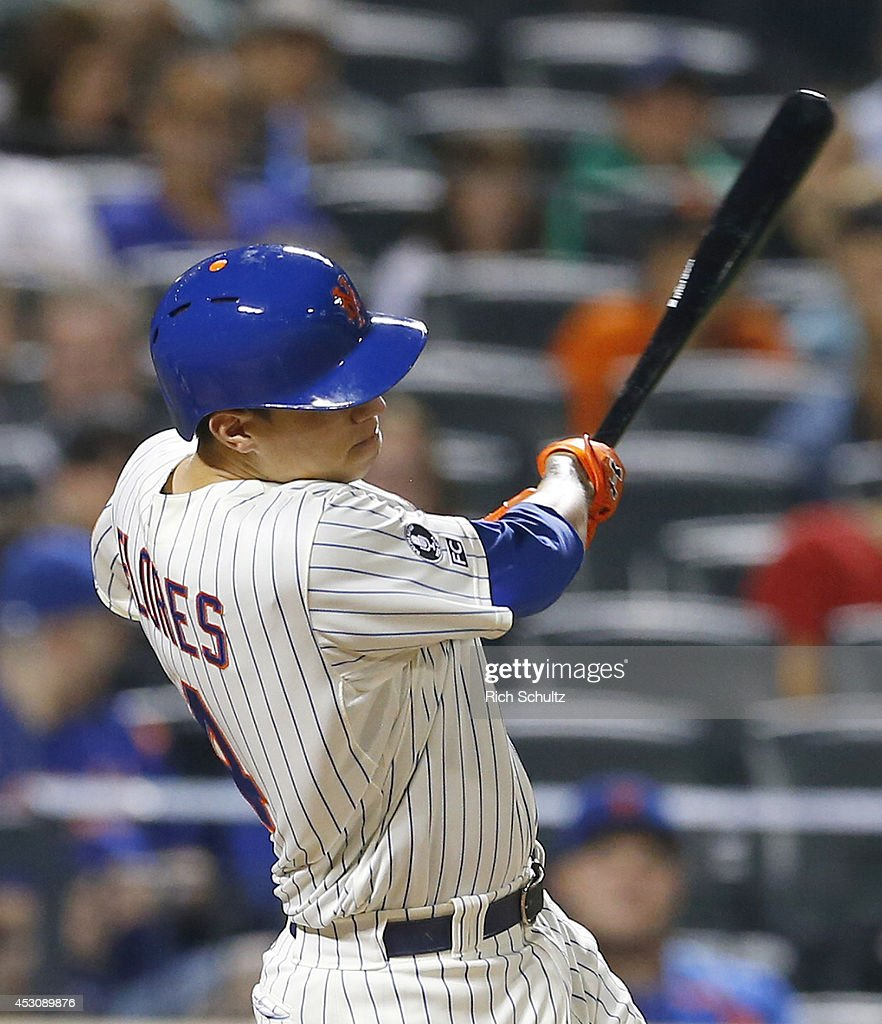 Wilmer Flores #4 of the New York Mets hits a two run double in the seventh inning against the San Francisco Giants on August 2, 2014 at Citi Field in the Flushing neighborhood of the Queens borough of New York City.