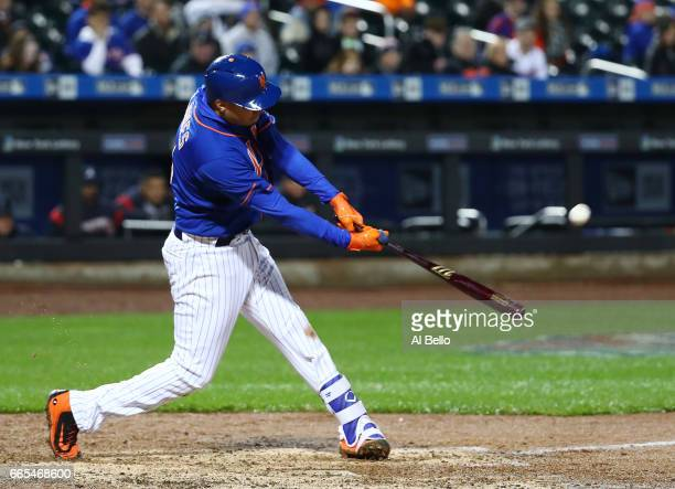 Wilmer Flores of the New York Mets hits a two run home run in the sixth inning against the Atlanta Braves during their game at Citi Field on April 6...