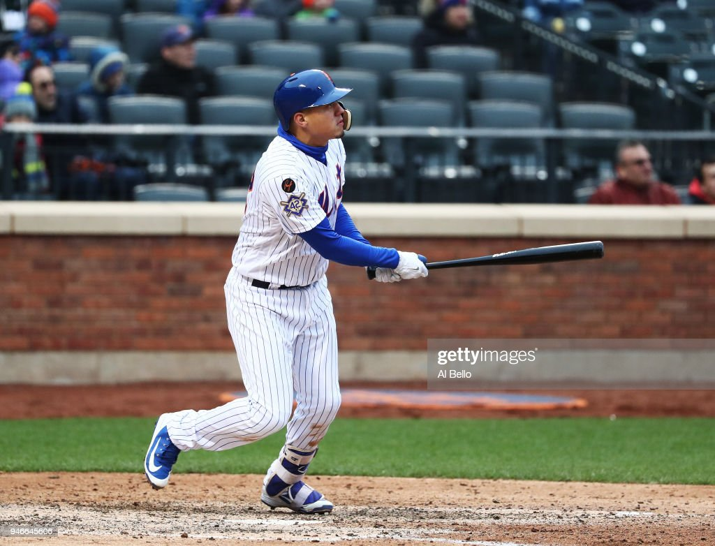 Wilmer Flores #4 of the New York Mets hits a walkoff home run in the ninth inning to win the game 3-2 against the Milwaukee Brewers at Citi Field on April 15, 2018 in New York City. All players are wearing #42 in honor of Jackie Robinson Day.
