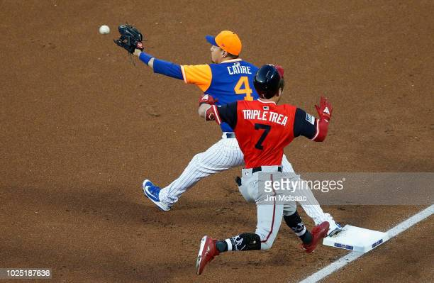 Wilmer Flores of the New York Mets in action against Trea Turner of the Washington Nationals at Citi Field on August 24 2018 in the Flushing...