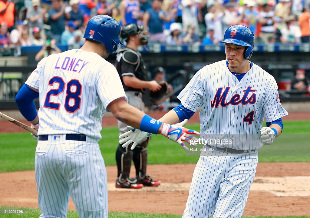 Wilmer Flores #4 of the New York Mets is congratulated by James Loney #28 after he hit a home run against the Miami Marlins in a game at Citi Field on July 6, 2016 in the Flushing neighborhood of the Queens borough of New York City.