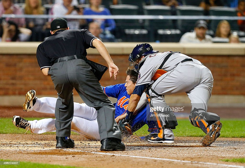 Wilmer Flores #4 of the New York Mets is tagged out at home for the final out of the second inning by Jason Castro #15 of the Houston Astros at Citi Field on September 27, 2014 in the Flushing neighborhood of the Queens borough of New York City.