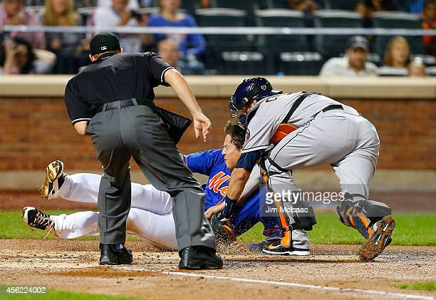 Wilmer Flores of the New York Mets is tagged out at home for the final out of the second inning by Jason Castro of the Houston Astros at Citi Field...