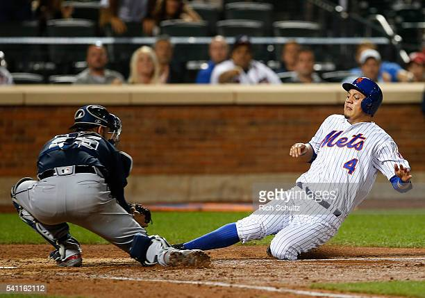 Wilmer Flores of the New York Mets is tagged out at the plate by catcher Tyler Flowers of the Atlanta Braves during the ninth inning of a game at...