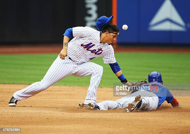 Wilmer Flores of the New York Mets misses the tag on Chris Coghlan of the Chicago Cubs in the eighth inning during their game at Citi Field on July 2...