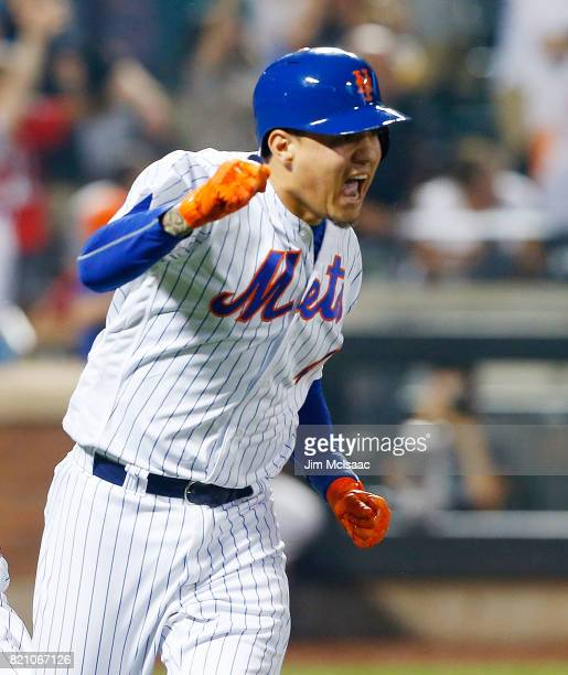Wilmer Flores of the New York Mets reacts after his ninth inning game winning home run against the Oakland Athletics at Citi Field on July 22 2017 in...