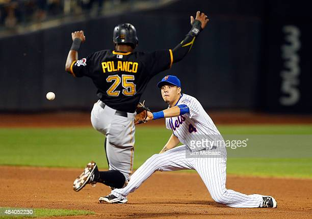 Wilmer Flores of the New York Mets receives the throw for a tag out of Gregory Polanco of the Pittsburgh Pirates completing a sixth inning double...