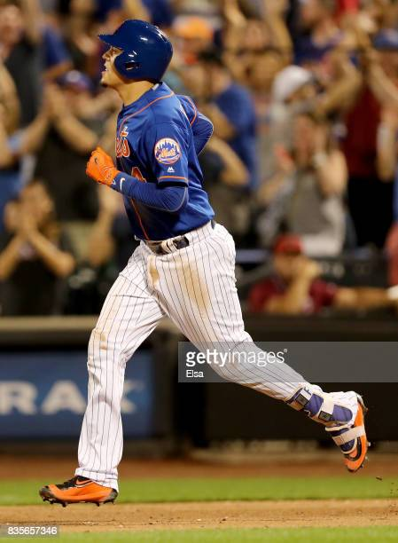 Wilmer Flores of the New York Mets rounds the bases after his two run home run in the sixth inning against the Miami Marlins on August 19 2017 at...