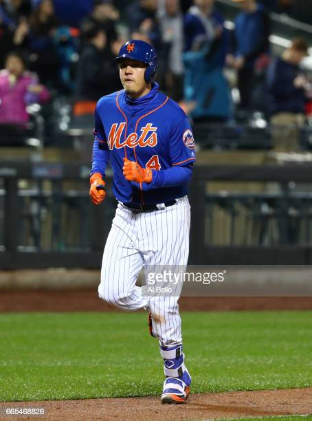Wilmer Flores of the New York Mets rounds the bases after hitting a tworun home run in the sixth inning against Jaime Garcia of the Atlanta Braves...