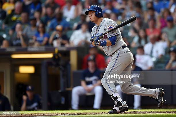 Wilmer Flores of the New York Mets swings at a pitch during the seventh inning of a game against the Milwaukee Brewers at Miller Park on June 11 2016...