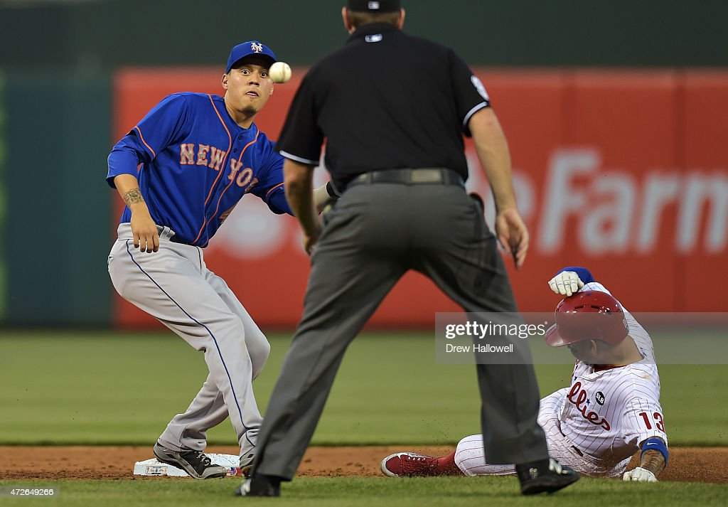 Wilmer Flores #4 of the New York Mets waits to catch the ball as Freddy Galvis #13 of the Philadelphia Phillies steals second base in the third inning at Citizens Bank Park on May 8, 2015 in Philadelphia, Pennsylvania.