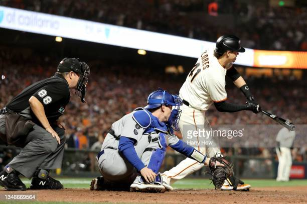 Wilmer Flores of the San Francisco Giants strikes out on a checked swing for the final out of the game against the Los Angeles Dodgers during the...