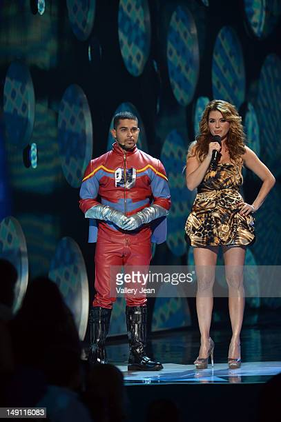 Wilmer Valderrama and Alicia Machado onstage during Univision's Premios Juventud Awards at Bank United Center on July 19 2012 in Miami Florida