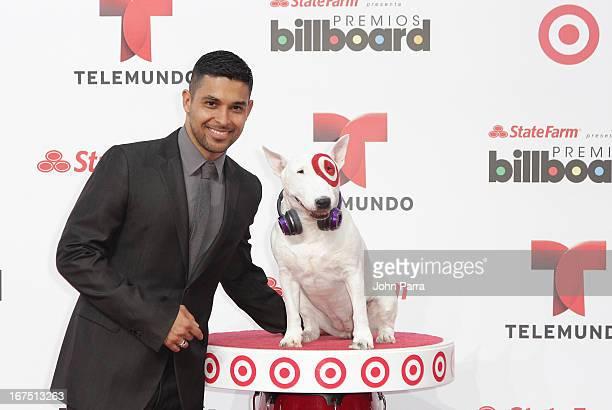 Wilmer Valderrama celebrates with Bullseye Target's Beloved Bull Terrier Mascot at the 2013 Billboard Latin Music Awards at BankUnited Center on...