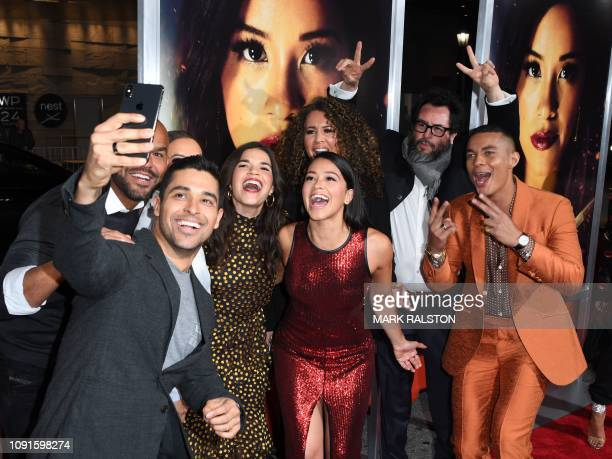 TOPSHOT Wilmer Valderrama takes a selfie with America Ferrera Gina Rodriguez and Ismael Cruz Cordova upon arriving for the premiere of Columbia...