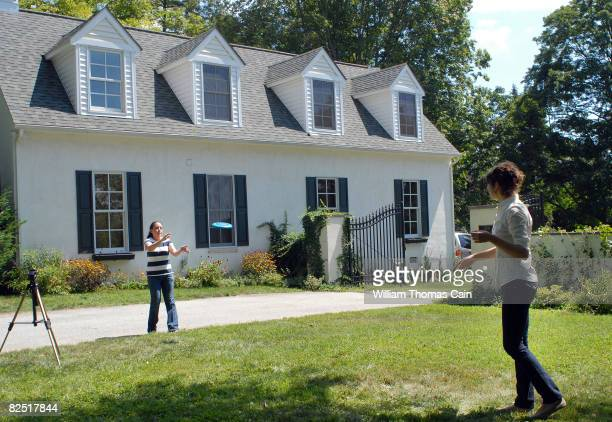 Wilmington News Journal reporters Ginger Gibson and Kristen Moses play frisbee while media members camp out in front of Delaware Senator Joe Biden's...