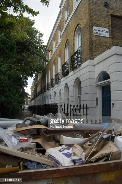 Wilmington Square Clerkenwell Islington London 2007 General view looking along the south side of the square from the southwest with a skip full of...