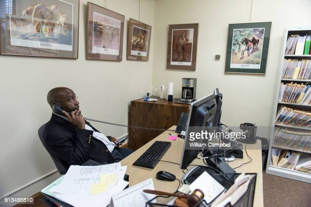 Wilmot Collins the newly elected Mayor of Helena Montana in his desk during his first month in office' Wilmot Collins is a former Liberian refugee...