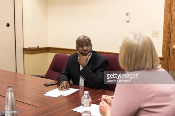 Wilmot Collins the newly elected Mayor of Helena Montana listens to a colleague while attending a public health meeting during his first month of...