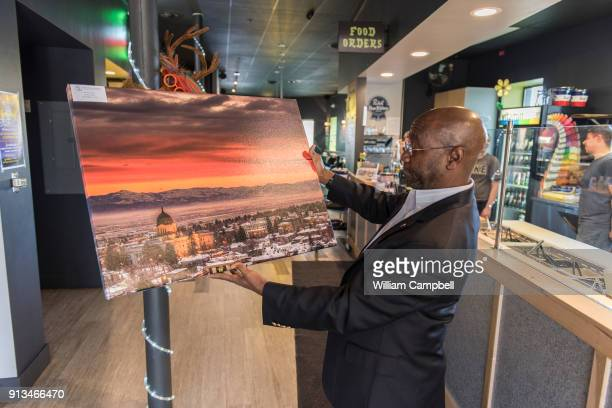 Wilmot Collins the newly elected Mayor of Helena Montana purchases a photograph of Helena for his office Wilmot Collins is a former Liberian refugee...