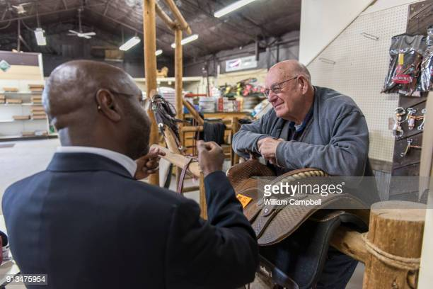 Wilmot Collins the newly elected Mayor of Helena Montana visits with Bruce Nachtsheim at his Agri Feeds store in Helena Bruce and his wife Joyce...