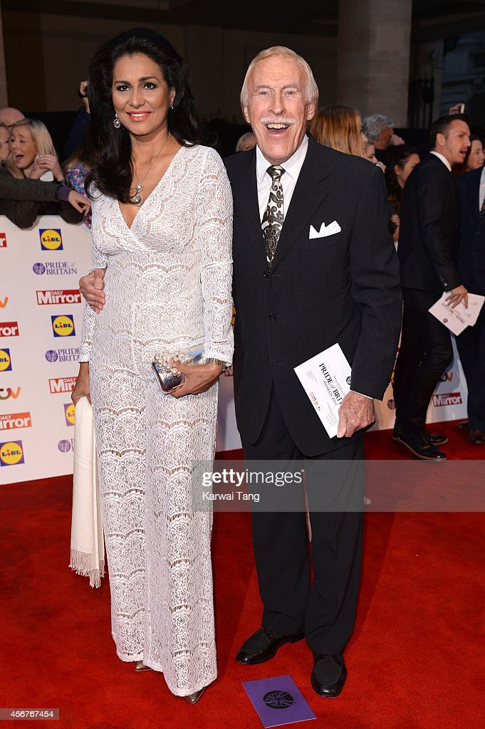 Wilnelia Merced and Bruce Forsyth attend the Pride of Britain awards at The Grosvenor House Hotel on October 6, 2014 in London, England.